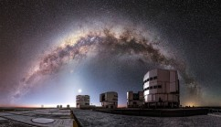 The entire arc of Milky Way, full of gas and dust, star clusters and emission nebulae, is a luminous background for the ESO-operated Very Large Telescope (VLT). The VLT is based at the Cerro Paranal site in the Atacama Desert of northern Chile, and it houses four 8.2-metre Unit Telescopes known as Antu, Kueyen, Melipal and Yepun, shown here lined up in front of a stunning starry backdrop. (Miguel Claro / ESO)